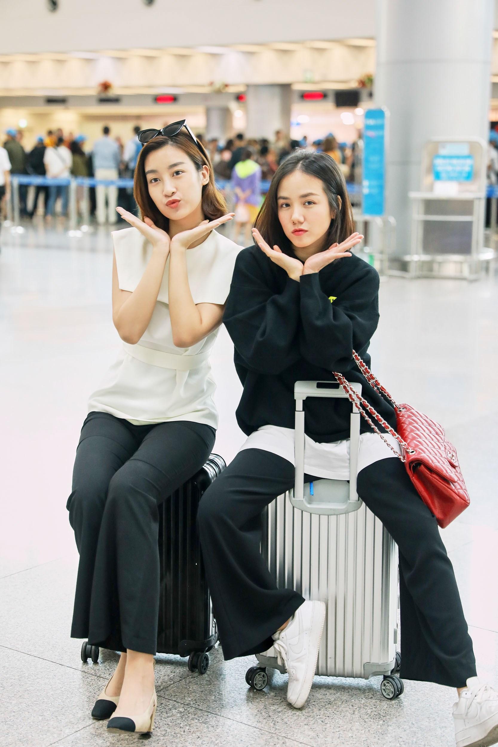 Hoa hậu Đỗ Mỹ Linh và Phương Ly đọ mặt mộc xinh đẹp tại sân bay Ảnh 15