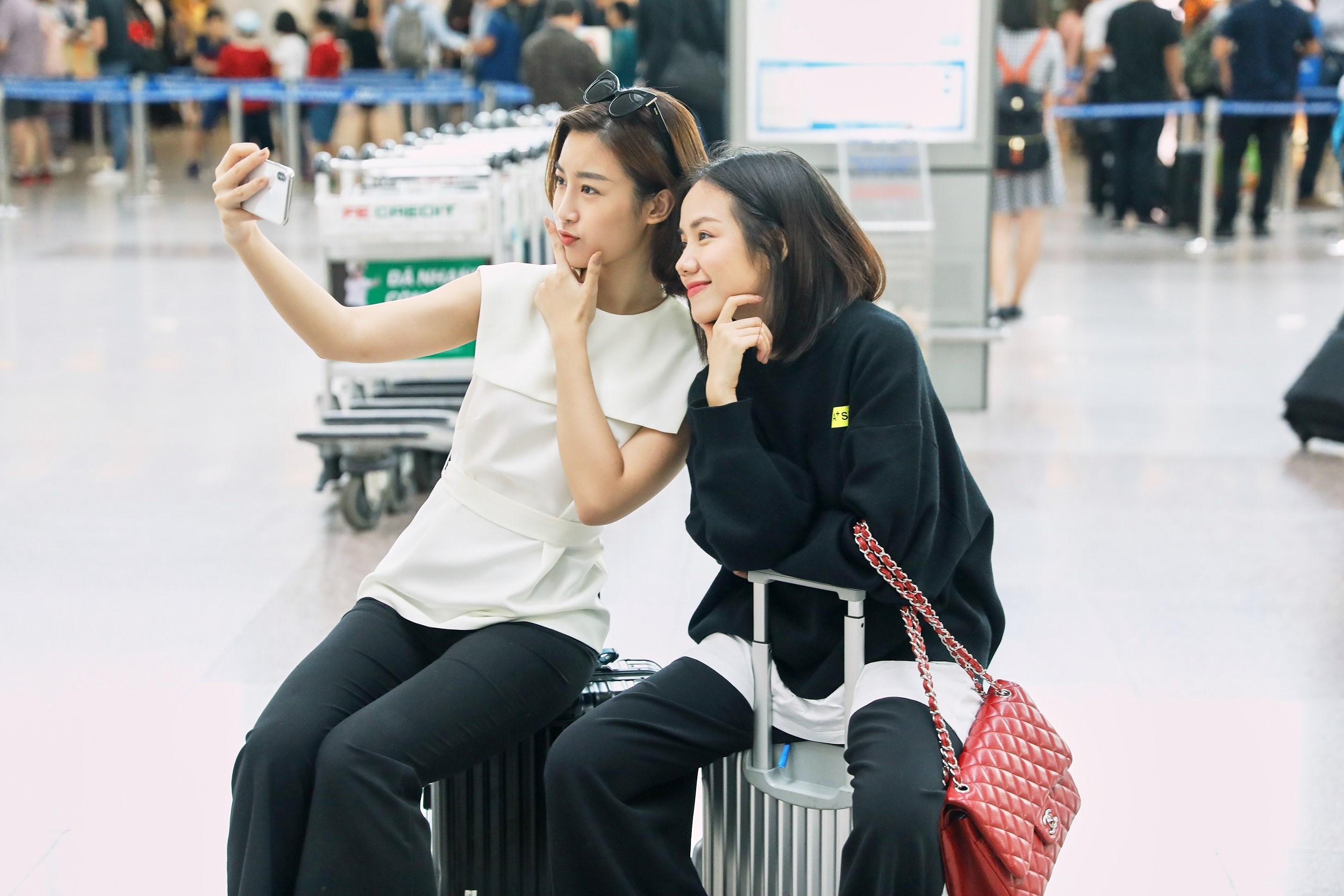 Hoa hậu Đỗ Mỹ Linh và Phương Ly đọ mặt mộc xinh đẹp tại sân bay Ảnh 8