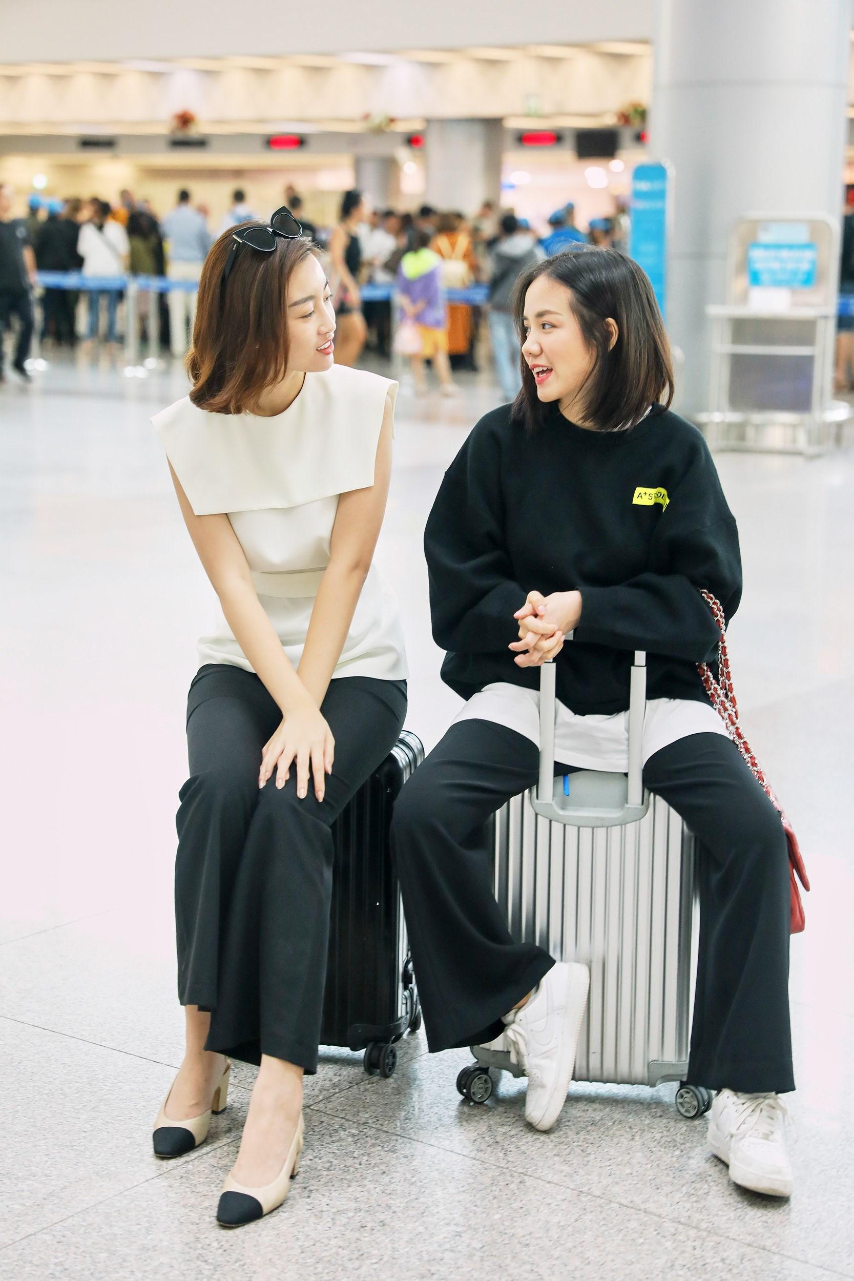 Hoa hậu Đỗ Mỹ Linh và Phương Ly đọ mặt mộc xinh đẹp tại sân bay Ảnh 16