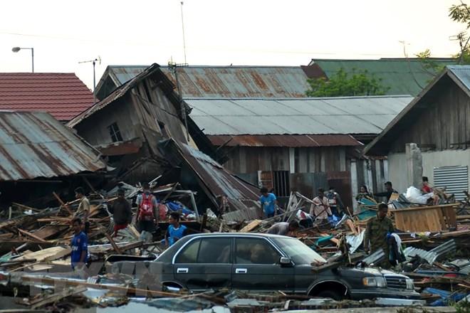 Những hình ảnh ám ảnh về thảm họa động đất, sóng thần ở Indonesia Ảnh 9