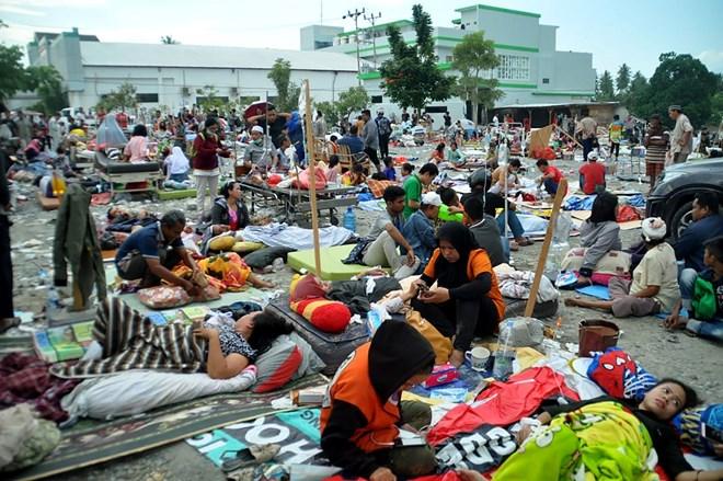 Những hình ảnh ám ảnh về thảm họa động đất, sóng thần ở Indonesia Ảnh 2
