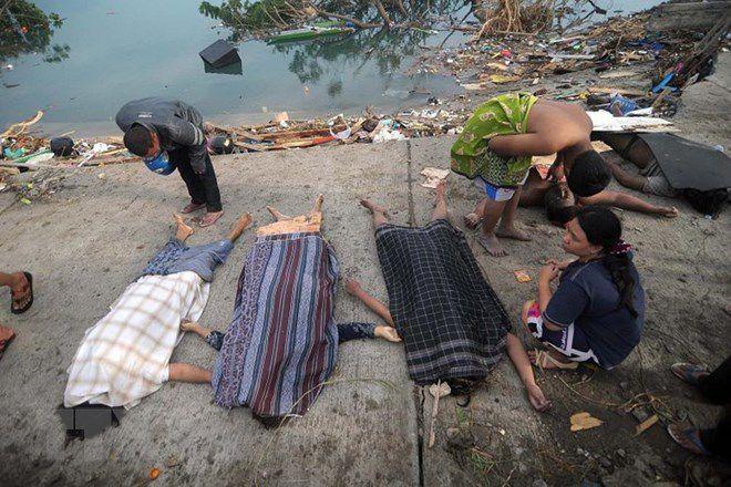 Những hình ảnh ám ảnh về thảm họa động đất, sóng thần ở Indonesia Ảnh 10