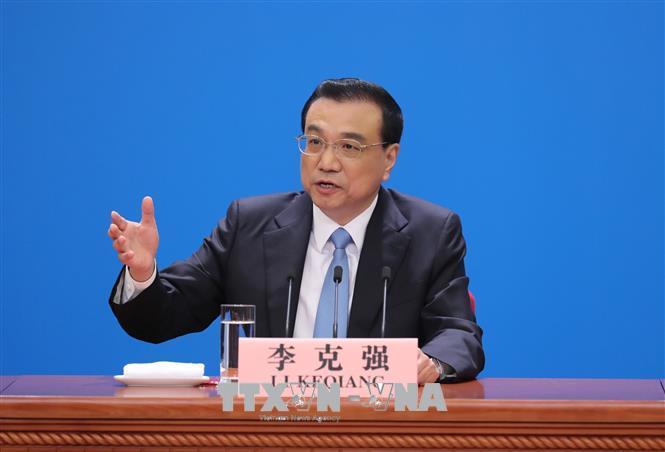 Trung Quốc khẳng định lập trường cứng rắn với chính sách bảo hộ thương mại của Mỹ Ảnh 1