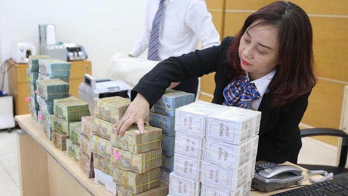 Các ngân hàng đồng loạt công bố lợi nhuận 'khủng' Ảnh 1
