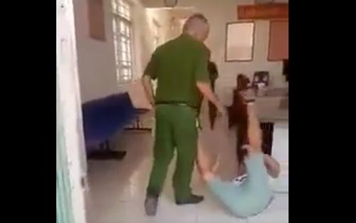 Tạm đình chỉ Trung tá công an 'lấy chân tác động' vào dân