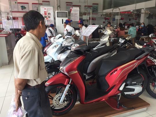 Honda Việt Nam hứa tăng sản lượng, hạn chế đội giá xe tay ga Ảnh 1