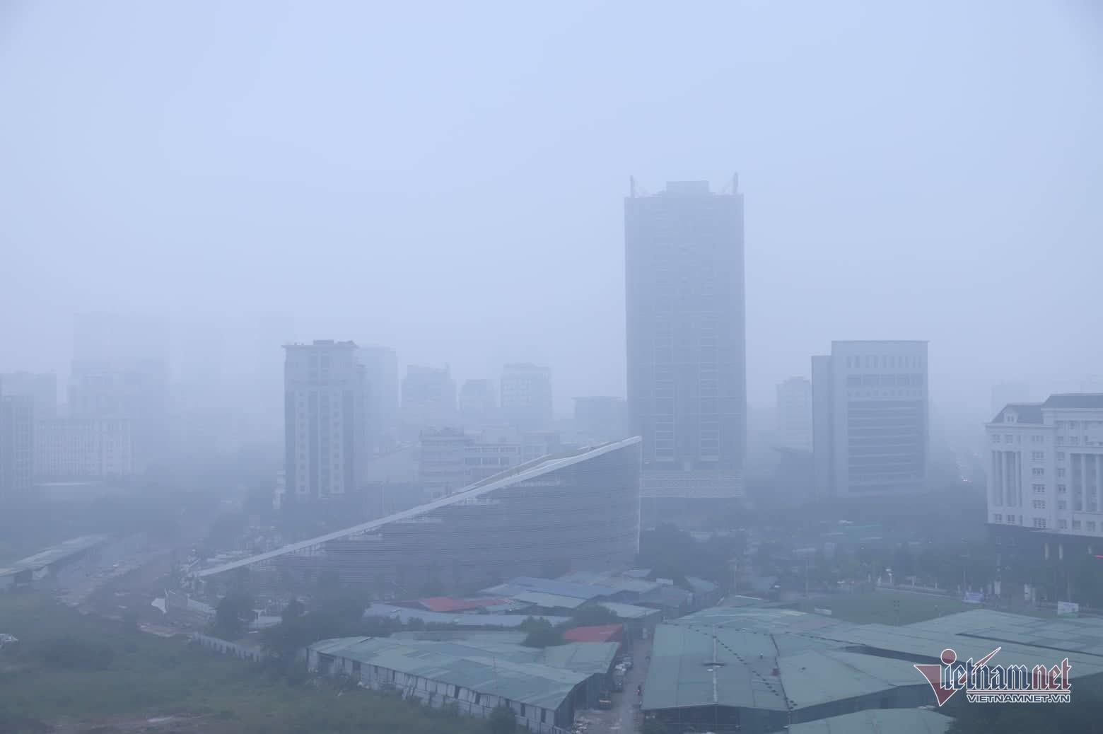 Sương mù giăng phủ Hà Nội, cao ốc mất hút Ảnh 14