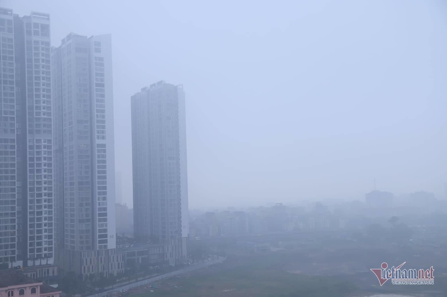 Sương mù giăng phủ Hà Nội, cao ốc mất hút Ảnh 13