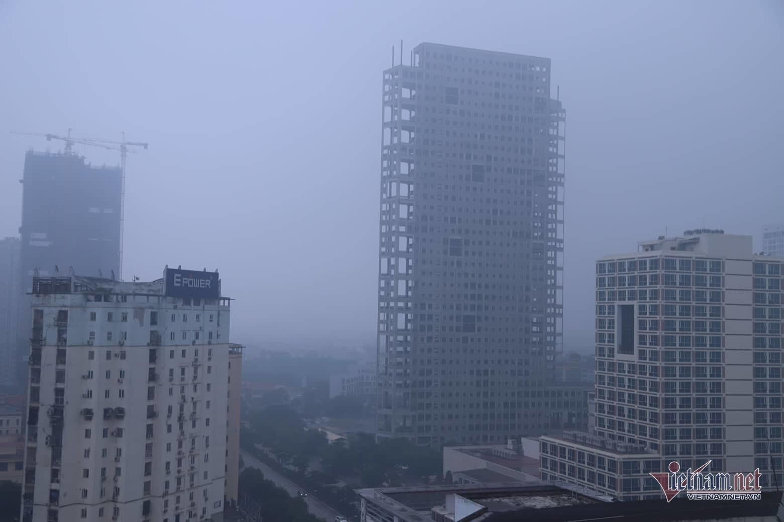 Sương mù giăng phủ Hà Nội, cao ốc mất hút Ảnh 11