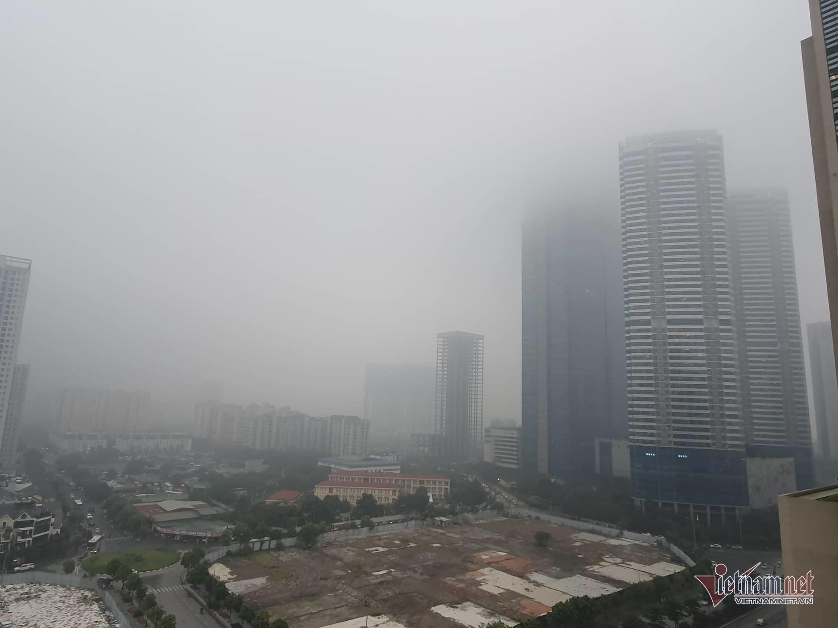 Sương mù giăng phủ Hà Nội, cao ốc mất hút Ảnh 9