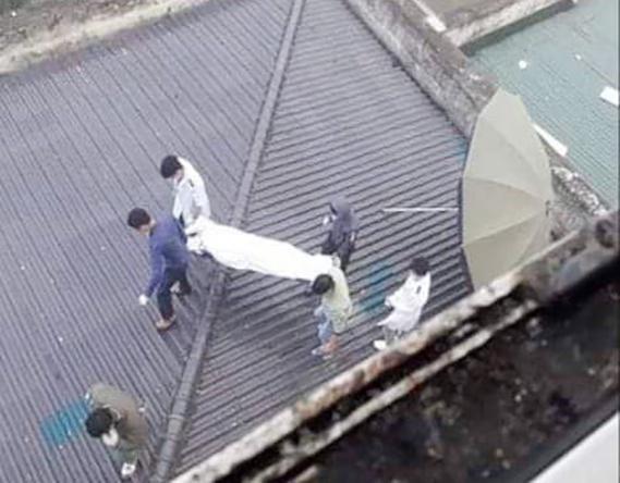 Thi thể người đàn ông trên mái nhà của bệnh viện Ảnh 1