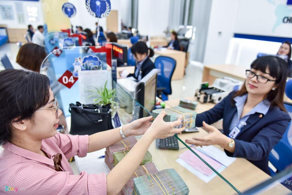 Thưởng Tết 5-7 tháng lương, nhân viên ngân hàng vẫn hụt hẫng Ảnh 2