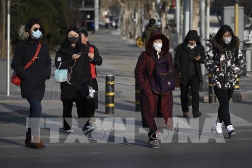Dịch viêm phổi do virus corona đe dọa đà phục hồi kinh tế Trung Quốc Ảnh 1