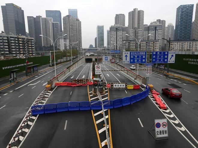Dịch virus Vũ Hán sẽ đẩy kinh tế Trung Quốc rơi vào suy thoái? Ảnh 1