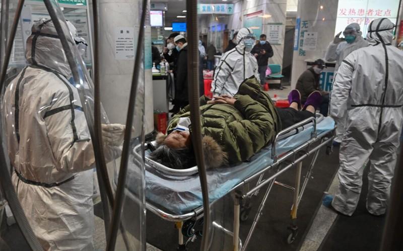 Công nhân nhà xác làm việc cật lực để hỏa táng người chết vì nCoV Ảnh 1
