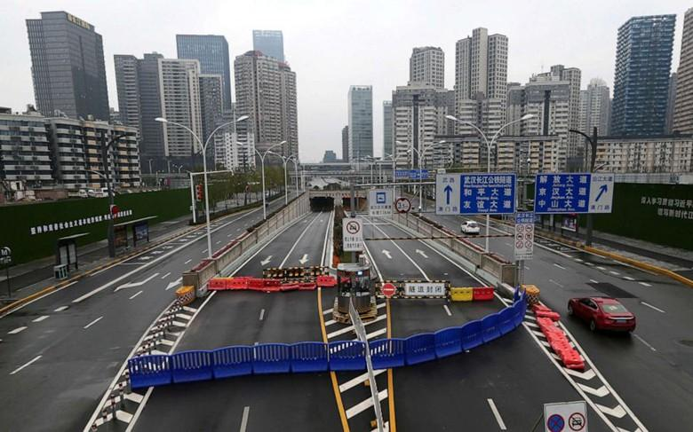 Những đô thị nhộn nhịp của Trung Quốc hóa 'thành phố ma' vì nCoV Ảnh 18