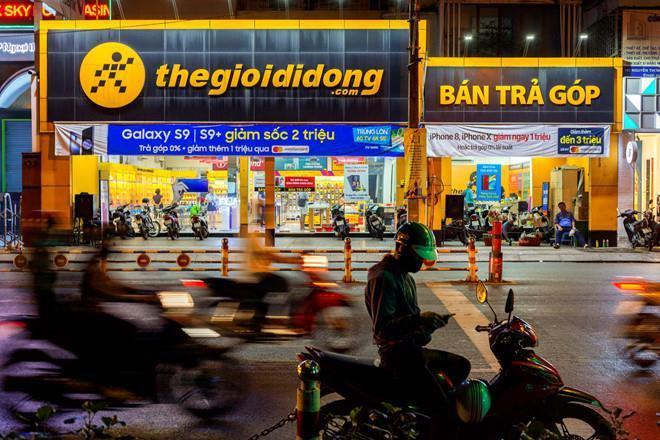 Thế Giới Di Động của ông Nguyễn Đức Tài 'oằn mình' gánh nợ đến 13.000 tỷ Ảnh 1