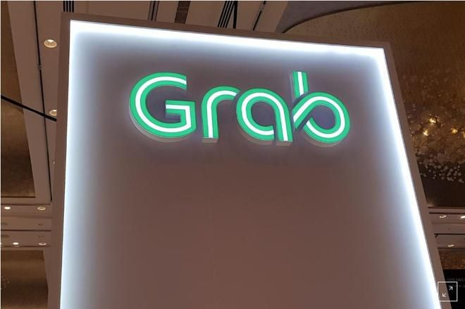 Grab thừa nhận tổng doanh thu lao dốc vì dịch Covid-19 Ảnh 1