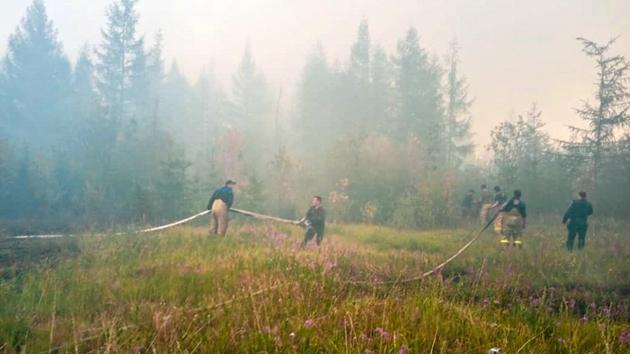 Cháy rừng dữ dội khắp Siberia giữa cái nóng kỷ lục 38 độ C Ảnh 1