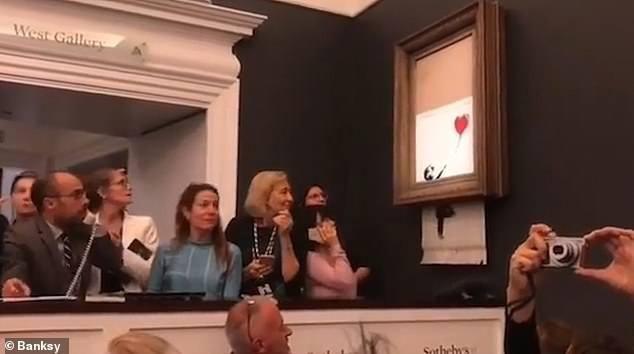 Sửng sốt bức tranh của Banksy trị giá 31 tỷ đồng tự động bị tiêu hủy Ảnh 2