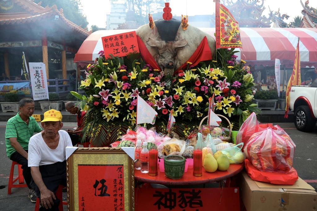 Lễ hội rước 'lợn thần' gây tranh cãi ở Đài Loan Ảnh 8