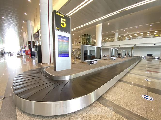 Sân bay Nội Bài sôi động trở lại sau kỳ nghỉ 'COVID -19' Ảnh 12