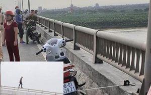 Nhiều người phát hoảng chứng kiến cô gái nhảy sông Hồng tự vẫn