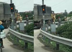 Hai CSGT bám vào cửa, xe tải vẫn điên cuồng bỏ chạy: Tạm giữ tài xế