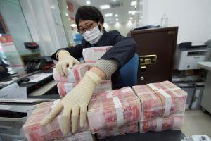 Trung Quốc tiêu hủy tiền mặt lưu hành ở vùng dịch