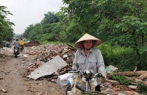 Yêu cầu rào chắn, chống đổ trộm phế thải trên đường Vĩnh Hoàng