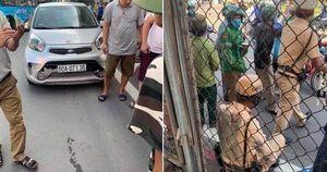 Khởi tố tài xế ô tô kéo lê trung úy CSGT hàng chục mét trên đường Hà Nội