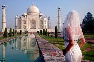 Buồn tình, cô gái mặc váy cưới du lịch vòng quanh thế giới