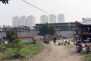 Việc di dời ngôi mộ tập thể ở Thanh Trì là do UBND xã thực hiện