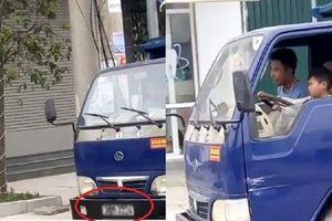 Phạt 8 triệu đồng chủ xe để bé trai 8 tuổi cầm lái ô tô tải