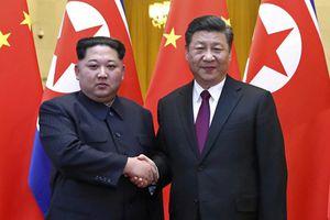 Kim Jong Un hội đàm Tập Cận Bình tại Bắc Kinh
