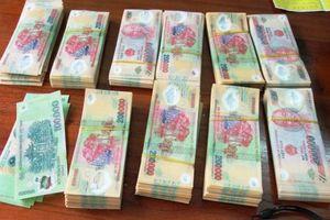 Tạm giữ hình sự 2 mẹ con tàng trữ 60 triệu đồng tiền giả