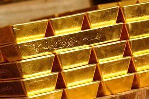 Giá vàng chật vật thu hẹp đà giảm