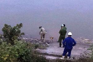 Phát hiện người đàn ông chết bất thường trên sông Lam