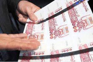 Algeria in thêm tiền để giải quyết khó khăn tài chính trong nước