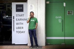 Thương vụ Grab mua Uber có khả năng bị Singapore hủy bỏ