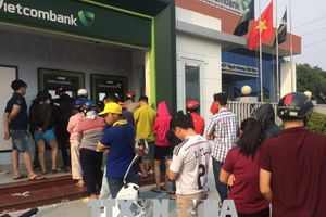Ngân hàng Nhà nước chưa cho phép các ngân hàng tăng phí rút tiền nội mạng