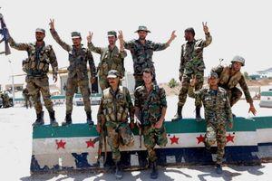 Phe nổi dậy đầu hàng, giao nộp vũ khí hạng nặng cho Assad
