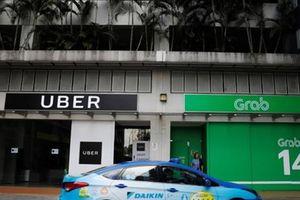 Grab 'mua đứt' Uber liệu có phải nộp khoản thuế 53,3 tỷ đồng?