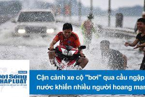 Cảnh xe cộ 'bơi' qua cầu ngập nước ở ngoại thành Hà Nội khiến nhiều người hoang mang