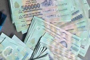 Tìm chủ nhân để quên tiền trên xe taxi Mai Linh