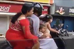 Bé gái 5 tuổi lái xe chở bố mẹ và em gái lao vun vút trên đường