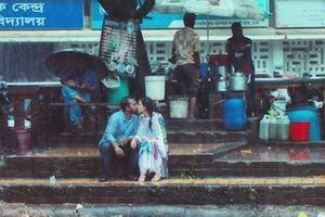 Kết đắng của nhiếp ảnh gia chụp bức ảnh 'hôn nhau dưới mưa'