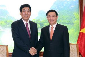 Phó Thủ tướng Vương Đình Huệ tiếp Bí thư Tỉnh ủy Cát Lâm (Trung Quốc)