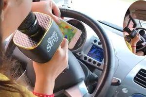 Clip: Thót tim xem cô gái vừa lái ô tô vừa hát karaoke giữa đường phố đông đúc
