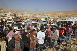 Thánh chiến bại trận, hàng chục nghìn dân Syria trở về tử địa Đông Ghouta